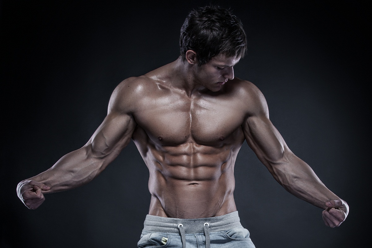 Strong Athletic Man Fitness Model Torso showing big muscles over