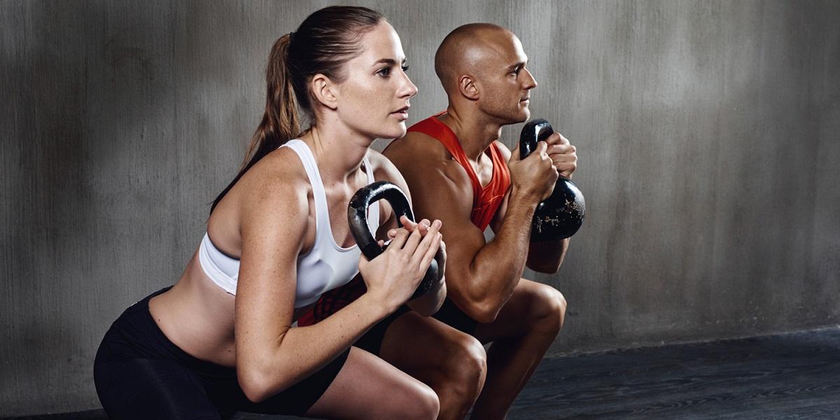 Mature Man Running On Treadmill In Gym